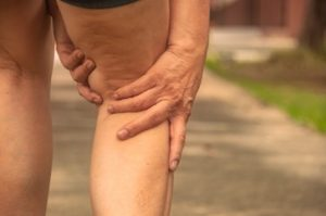 Swollen and twisted, varicose veins resemble raised, dark blue tunnels on the legs or ankles.