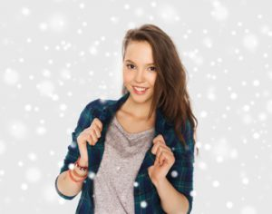 Woman in flanel shirt smiling