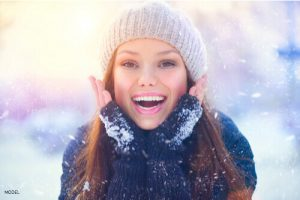 Girl smiling int he snow