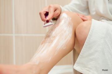 Person shaving their legs