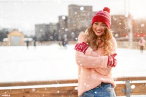 Woman wearing a sweater outside in the snow