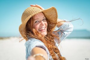 woman on the beach in a sun hat